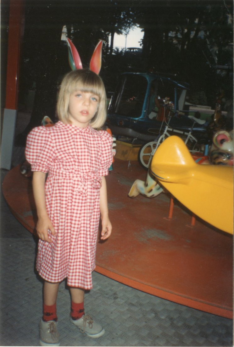 Even older picture of me early to mid-nineties near a carousel
