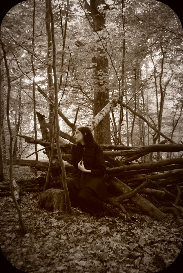 Witch vibes wearing Moi-Même-Moitié nun dress in an oversize nest in the forest