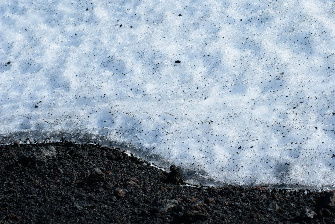 Snow and ashes on the slope of the volcano