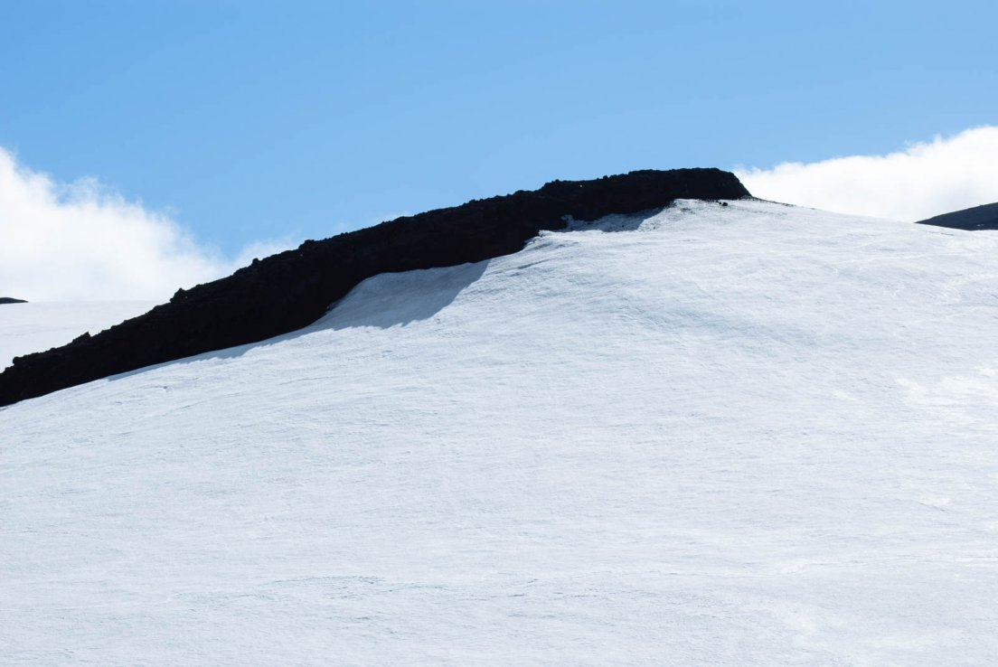 Snowy summit of the volcano