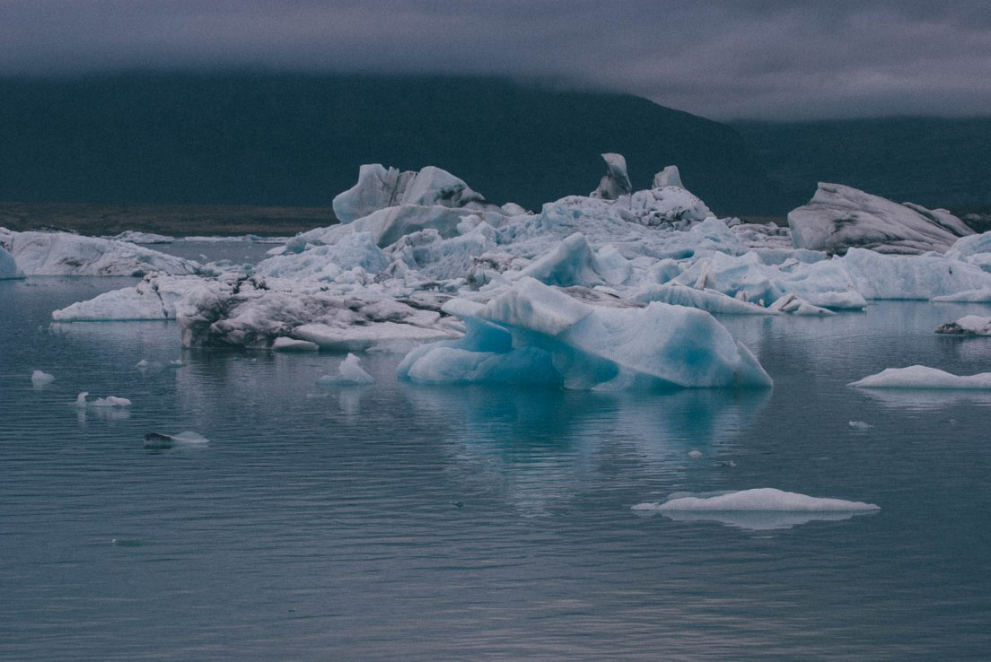 Moody photograph of a lake populated by icebergs