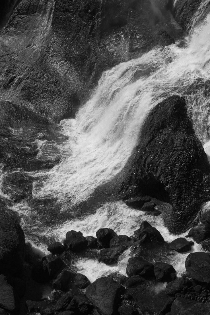 Black and white photograph of a detail of Fagrifoss waterfall