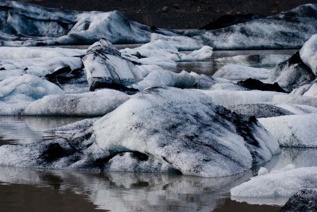 Half-melted and blackened icebergs