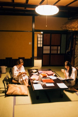 Western lady and her daughter sat in a traditional japanese room