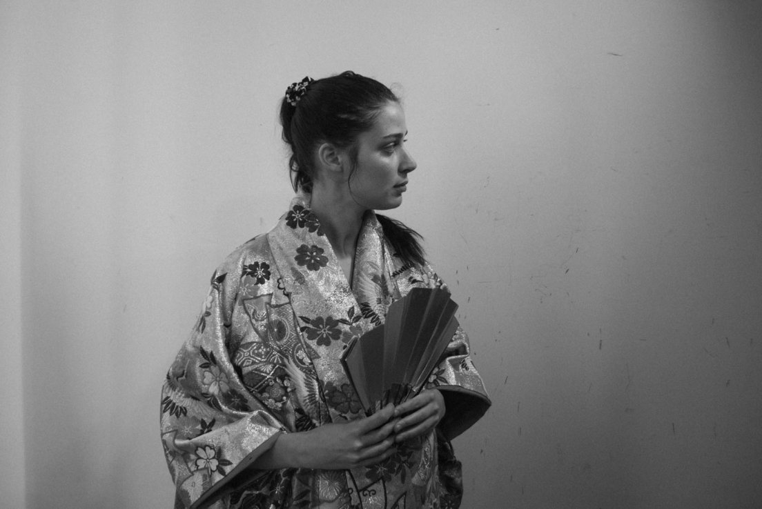 A western girl trying out a gold-embroidered kimono