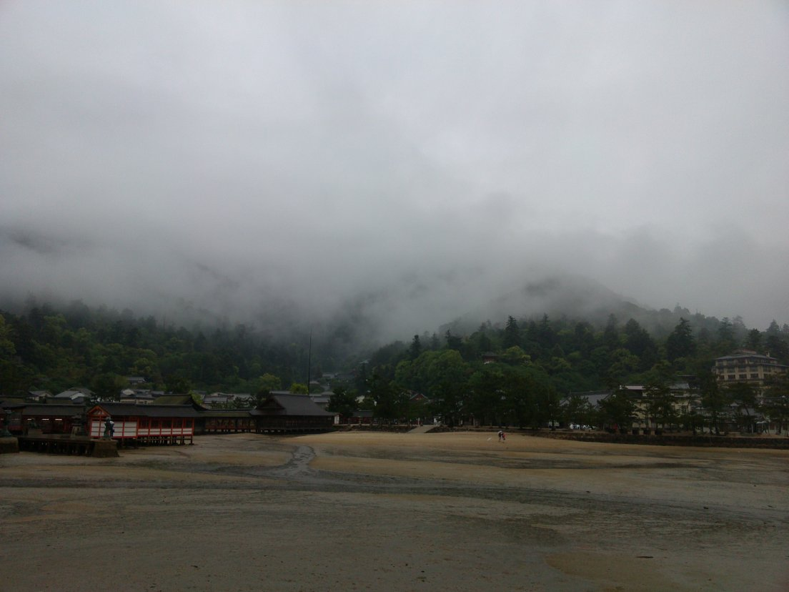 Low tide and cloudy hills