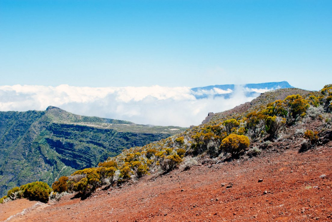 View on the volcano crater, red hearth and bright blue sky