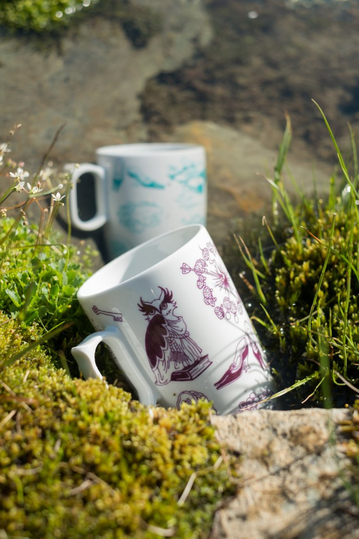 Purple and seafoam mugs from Enchanteresse, a hand-painted porcelain collection by messalyn, in a stream from the mountain