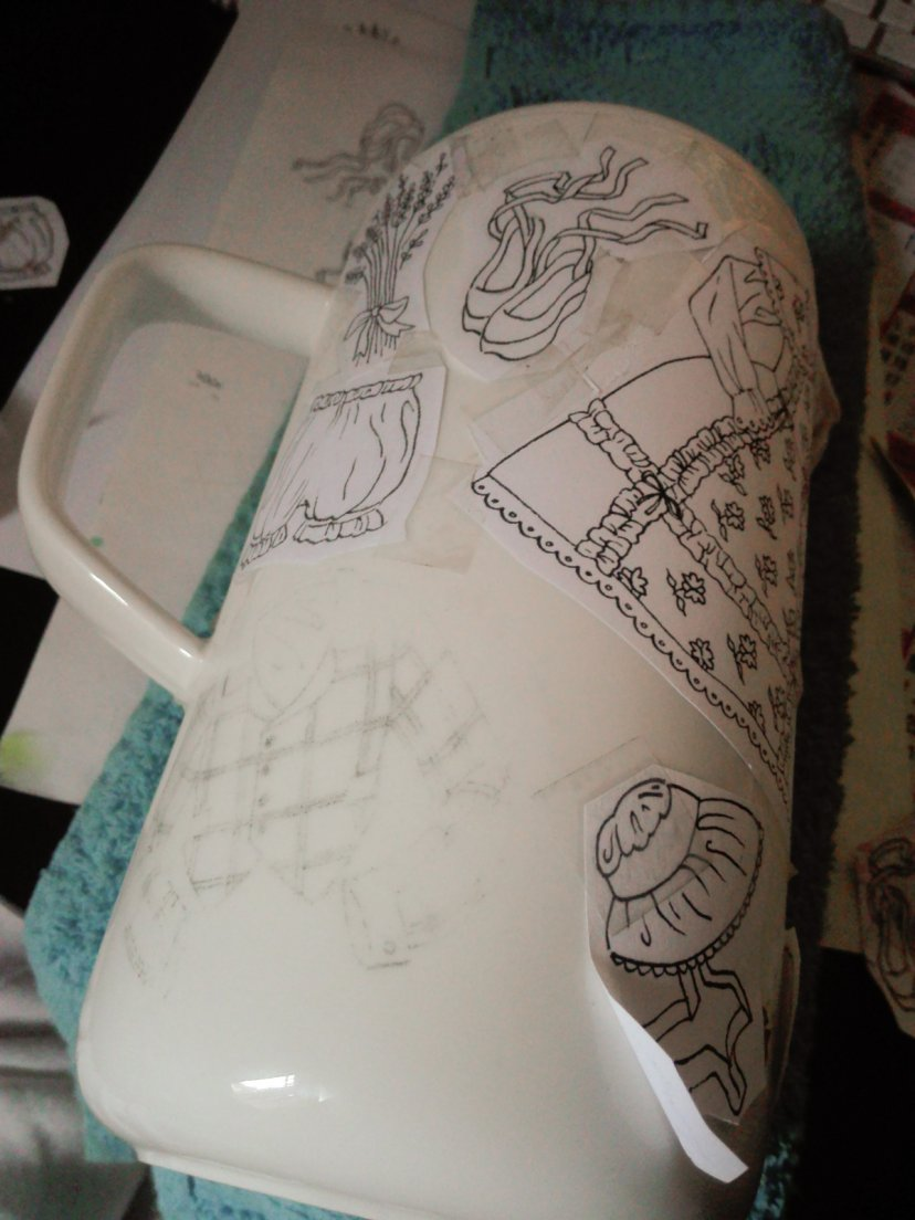 Drawings taped on a coffee pot from the composition step