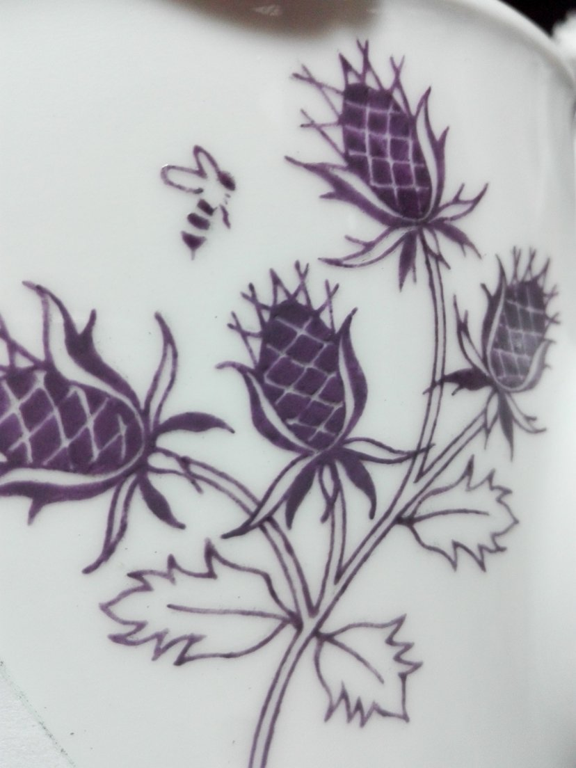 Purple thistle detail with uncleaned lines from Enchanteresse, a collection of hand-painted porcelains by messalyn