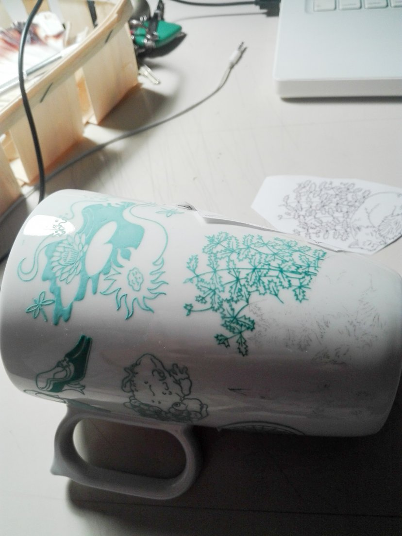 Work in progress on a seafoam mug from Enchanteresse, a hand-painted porcelain collection by messalyn