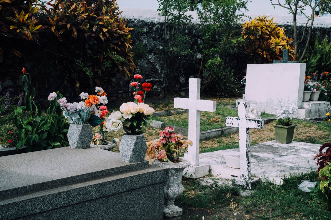 Graves with flowers in a tropical environnement, Reunion Island